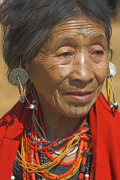 Naga (Macham tribe) lady with face tattoos, done during childhood so that they are not attractive to men who might steal them from their village, Magyan Village, Sagaing Division, Myanmar (Burma), Asia