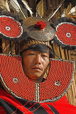 Naga man, Taungkul tribe wearing traditional headdress made with red seeds, from Sombra village near the Indian border, who walked for five days to get to the Naga New Year Festival, Lahe village, Sagaing Division, Myanmar (Burma), Asia