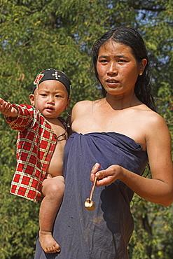 Wan Sai village (Aku tribe) Aku lady with baby, Kengtung (Kyaing Tong), Shan State, Myanmar (Burma), Asia