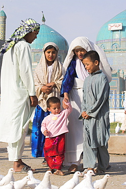 Family looking at famous white pigeons at the shrine of Hazrat Ali, who was assassinated in 661, Mazar-I-Sharif, Balkh province, Afghanistan, Asia