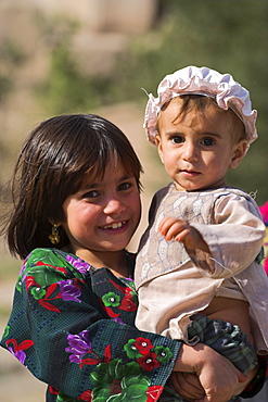 Aimaq girl holding baby, Pal-Kotal-i-Guk, between Chakhcharan and Jam, Afghanistan, Asia
