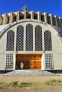 Pilgrim at doors of St. Mary of Zion new church, built by Haile Selassie in the 1960s, Axum, Ethiopia, Africa