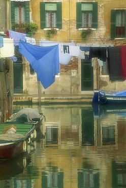 Laundry hung over canal to dry, The Ghetto, Venice, Veneto, Italy, Europe