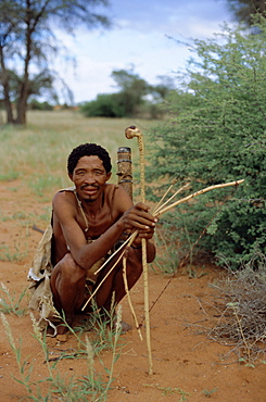 Bushman with bow and arrows, Intu Afrika game reserve, Namibia, Africa