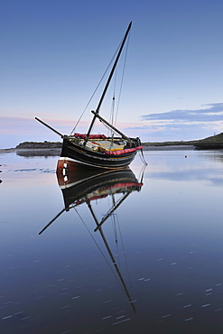 Old ketch reflecting in Aln Estuary as tide rises, Alnmouth, Northumberland, England, United Kingdom, Europe