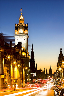 View along Waterloo Place at night towards Princes Street and the floodlit tower of the Balmoral Hotel, Edinburgh, Lothian, Scotland, United Kingdom, Europe