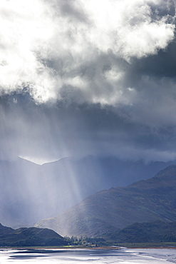 View from Carr Brae towards head of Loch Duich and Five Sisters of Kintail with sunlight bursting through sky, Highlands, Scotland, United Kingdom, Europe