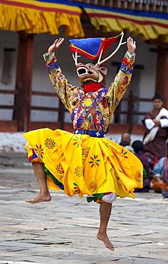 Monks performing traditional masked dance at the Wangdue Phodrang Tsechu, Wangdue Phodrang Dzong, Wangdue Phodrang (Wangdi), Bhutan, Asia