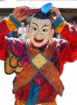 Clown with carved wooden penis on his head entertaining crowds at the Tamshing Phala Choepa Tsechu, near Jakar, Bumthang, Bhutan, Asia