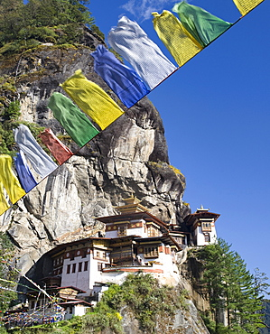 Taktshang Goemba (Tiger's Nest Monastery) and prayer flags, Paro Valley, Bhutan, Asia