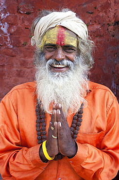 Sadhu (Holy Man) wearing brightly coloured clothing and characteristic facial painting at Pashupatinath Temple, Kathmandu, Nepal, Asia