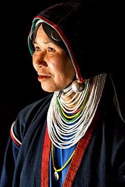 Woman of the Akha tribe in traditional dress, in a hill village near Kengtung (Kyaingtong), Shan State, Myanmar (Burma), Asia