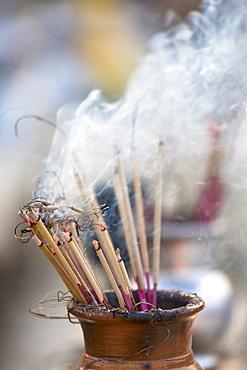 Incense burning at Shwedagon Paya (Pagoda), Yangon (Rangoon), Myanmar (Burma), Asia