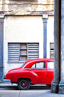 Red vintage American car parked on a street in Havana Centro, Havana, Cuba, West Indies, Central America