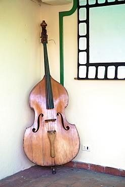 Double bass in restaurant, Vinales, Pinar Del Rio Province, Cuba, West Indies, Central America