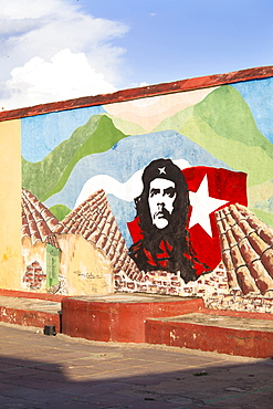 Mural of Che Guevara painted on a wall in a local school, Trinidad, Cuba