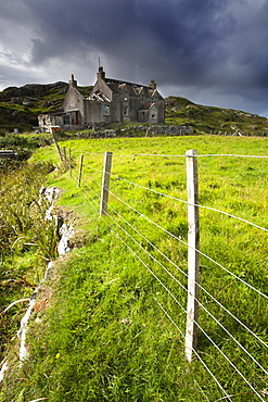Abandoned croft beneath a stormy sky in the township of Manish on the east coast of The Isle of Harris, Outer Hebrides, Scotland