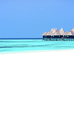 Tropical beach and over-water villas, Coco Palm, Dhuni Kolhu, Baa Atoll, Republic of Maldives, Indian Ocean, Asia