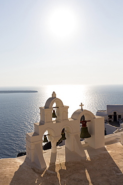 White church belltowers overlooking the Caldera, Oia, Santorini, Cyclades, Greek Islands, Greece, Europe