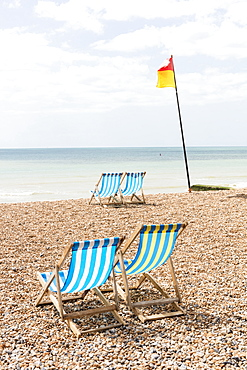 Deckchairs on the beach, Brighton, East Sussex, England, United Kingdom, Europe
