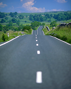 Undulating rural road through countryside, United Kingdom, Europe