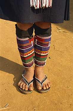 Close-up of legs and feet of a person of the Akha hill tribe wearing colourful cloth leg coverings, at Doitung, Chiang Rai, Golden Triangle, Thailand, Southeast Asia, Asia