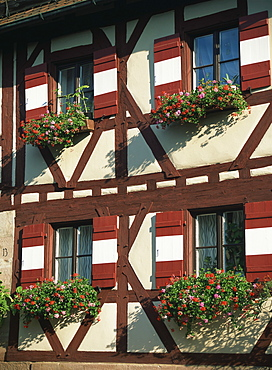 Flower baskets on half-timbered wall, Kaiserburg, Nuremberg, Bavaria, Germany, Europe