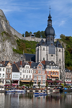 View across River Meuse showing Collegiate Church of Notre-Dame, Dinant, Wallonia, Belgium, Europe