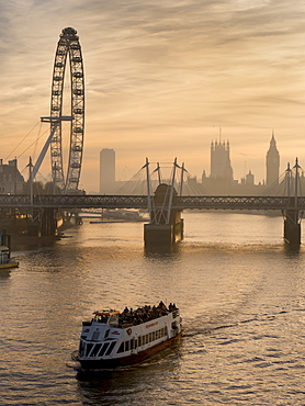 Millennium Wheel stands with Big Ben and tour boat at sunset, London, England, United Kingdom, Europe