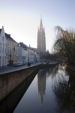 Looking south west along Dijver, towards The Church of Our Lady (Onze Lieve Vrouwekerk), Bruges, Belgium, Europe