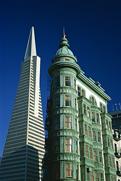 The Transamerica Pyramid, designed by the architect William Pereira and built in 1972, and Victorian style hotel building, San Francisco, California, United States of America, North America