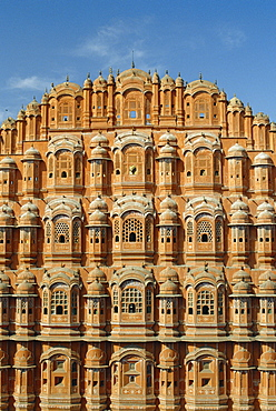 Detail of the facade of the Palace of the Winds or Hawa Mahal, showing windows for ladies in purdur to watch from, Jaipur, Rajasthan, India