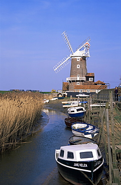 Boats on waterway and windmill, Cley next the Sea, Norfolk, England, United Kingdom, Europe