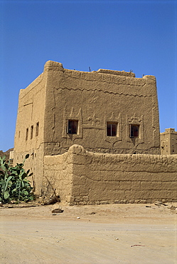 Mud built fortress house with decorated windows, Farawah, north Yemen, Middle East