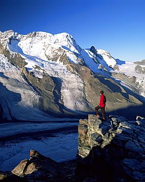 Hiker and view to the Breithorn and Breithorn Glacier, Gomergrat, Zermatt, Valais, Switzerland, Europe