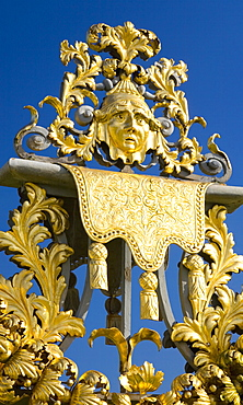 Detail of ornamental wrought iron gate in the Privy Garden, Hampton Court Palace, Borough of Richmond upon Thames, Greater London, England, United Kingdom, Europe