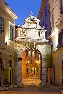 The Balbi Arch and pedestrianized Grisia illuminated at dusk, Rovinj (Rovigno), Istria, Croatia, Europe