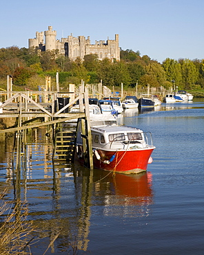 Colourful boats moored on the River Arun beneath the castle, Arundel, West Sussex, England, United Kingdom, Europe