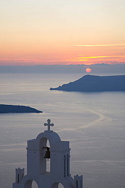 Sunset over the caldera, typical church in fore, Firostefani, Santorini (Thira) (Thera), Cyclades Islands, South Aegean, Greek Islands, Greece, Europe