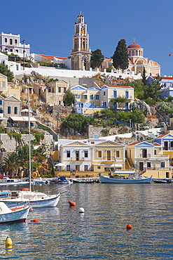 View over harbour to colourful houses and church, Gialos (Yialos), Symi (Simi), Rhodes, Dodecanese Islands, South Aegean, Greece, Europe