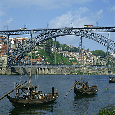 Barco rabelo, the port barges on the River Douro, with the Dom Luis I bridge behind in the city of Oporto, Portugal, Europe