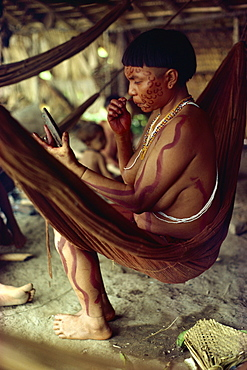 Yanomami Indian women with mirror, painting her face, Brazil, South America - 42-2288