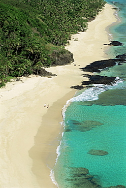 View down west coast of Yasawa Island, with two figures on beach, Fiji, Pacific Islands, Pacific