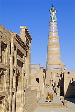 Islam Khodja minaret, Prince Makhmud mausoleum on left, Khiva, Uzbekistan, Central Asia