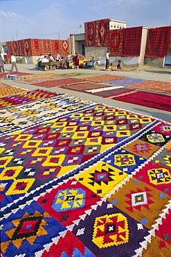 Carpet market, old city walls, Bukhara, Uzbekistan, Central Asia