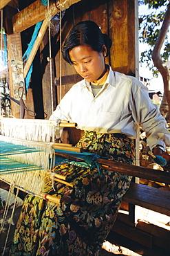 Intha girl weaves longyis, Inle Lake, Myanmar, Asia
