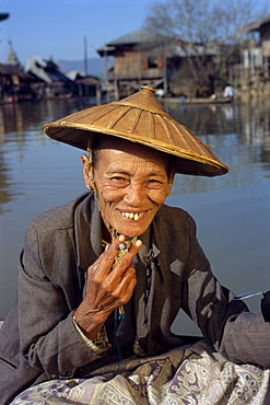 Portrait of an old woman with straw hat and cheroot, Inle Lake, Shan State, Myanmar (Burma), Asia