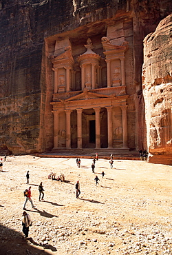 Tourists silhouetted in front of the Treasury (El Khazneh) (Al Khazna), Nabatean archaeological site of Petra, UNESCO World Heritage Site, Jordan, Middle East