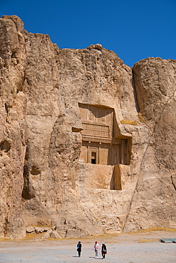 Tourists walking in front of Tomb of Darius the Great, Naqsh-e Rostam Necropolis, near Persepolis, Iran, Middle East