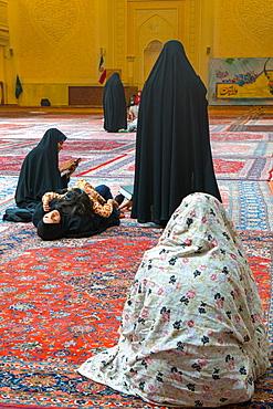 Women and child gathered, interior, Aramgah-e Shah-e Cheragh (Mausoleum of the King of Light), Shiraz, Iran, Middle East